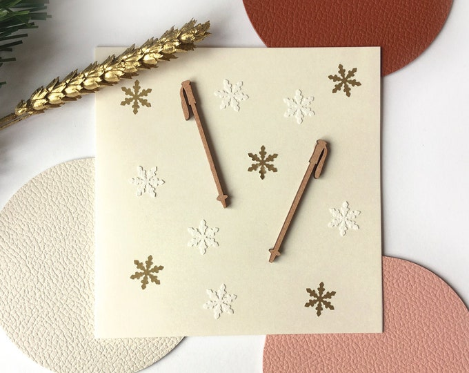 Merry Christmas and Happy New Year greeting card - Balsa ski stick shape - Cut-out white and gold flakes - double white card