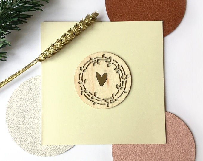 Merry Christmas and Happy New Year greeting card - Cut wood shape of twigs, golden heart - Double light beige card