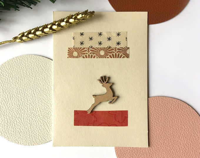 Double greeting card, Christmas and Happy New Year Rudolf the jumping reindeer - Card decorated with colorful cut-out papers on an iridescent beige background