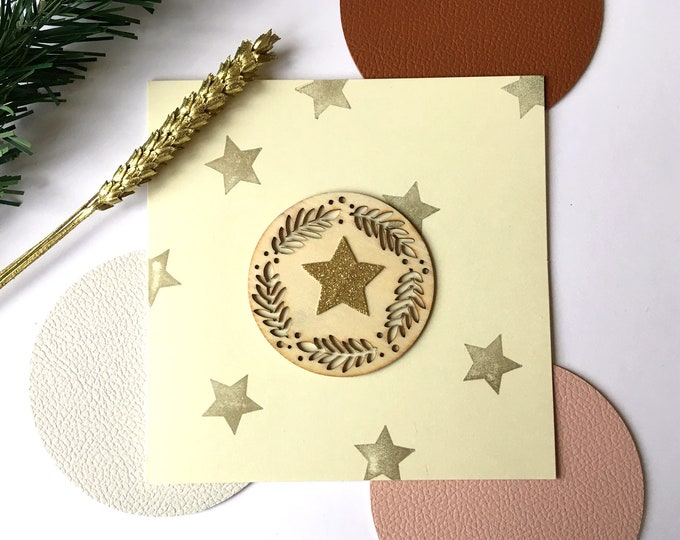 Merry Christmas and Happy New Year greeting card - Wood shape cut from twigs, golden and glitter stars - Double light beige card