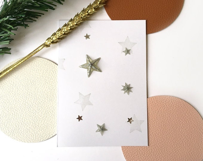 Merry Christmas greeting card and Happy New Year consisting of golden or silver stars on a white background