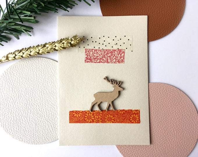 Double Christmas card, Merry Christmas greetings and Happy New Year Rudolf the reindeer - Card decorated with colorful cut-out papers on an iridescent beige background