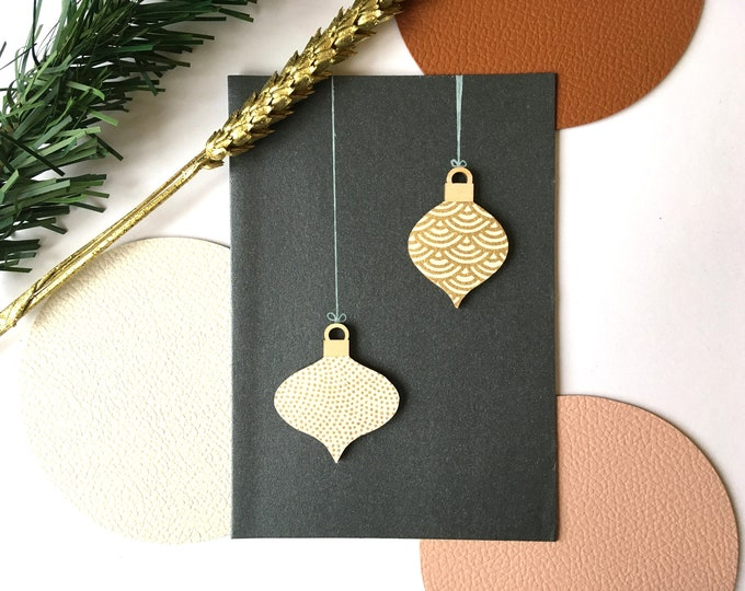 Double greeting card, Christmas and Happy New Year Christmas balls - Card decorated with cutouts of gold paper and wooden shapes on kraft background