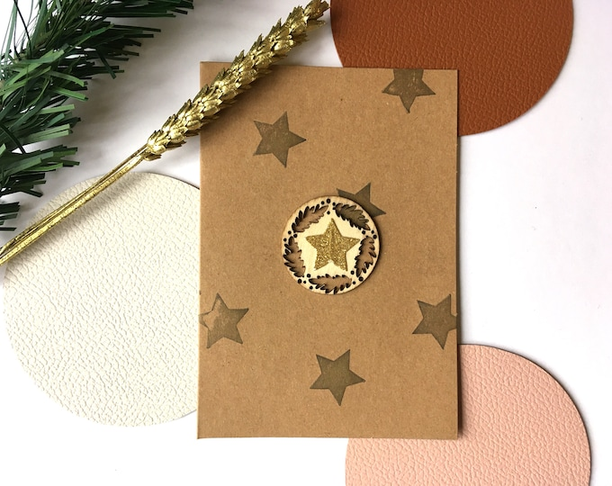 Merry Christmas and Happy New Year greeting card - Double card decorated with sequined gold stars and a wooden twig cutout on a kraft background