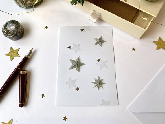 Greeting card - festive stationery - golden or silver Christmas stars on a white background