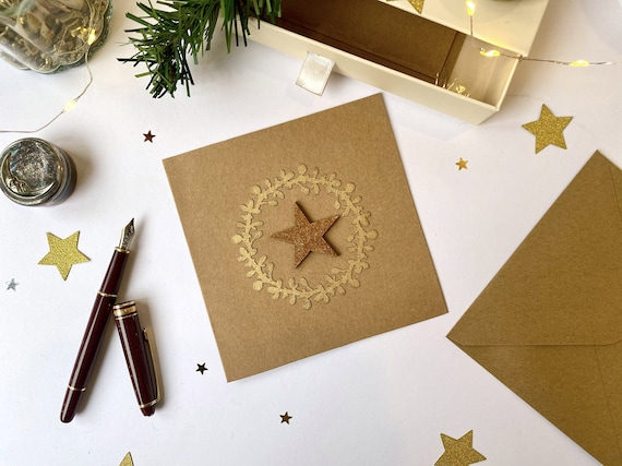 Greeting card - Festive stationery - Cuts of papers in the shape of green or gold Christmas wreaths - strawed gold wooden stars