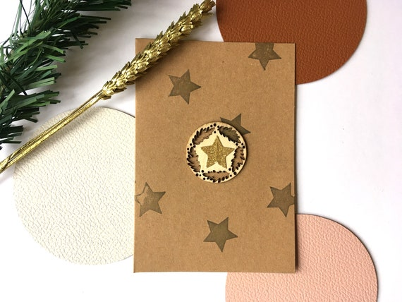 Greeting card - Festive stationery - Christmas card decorated with gold and glitter stars and a wooden twig cutout on a kraft background