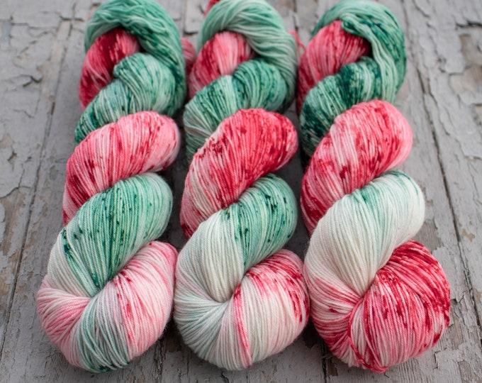 Featured listing image: Sock Yarn Christmas, Hand Dyed, Speckled, Superwash Merino Nylon Fingering Weight 100 g 460 yards, Staple Sock - Santa Claus Lane *In Stock