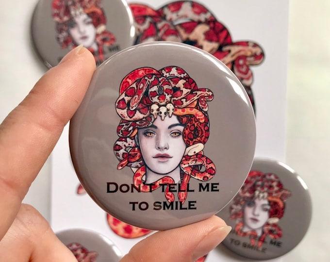 Don't Tell Me To Smile Medusa Button Pin