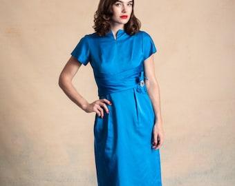 Vintage 1950s/early 60s bright blue satin finish cocktail dress / rhinestone hip detailing / cummerbund waist / size S/M