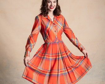 1950s Serbin of Florida long sleeve plaid shirt dress / orange with multicolored stripes / full pleated skirt / decorative metal buttons / s