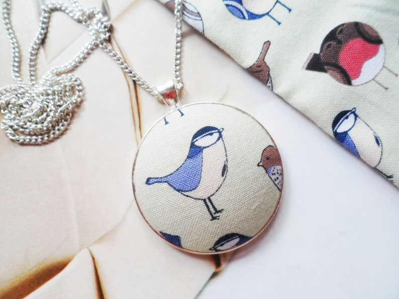 Scandinavian bird necklace with a cotton fabric pendant and silver plated chain Selma Dreams
