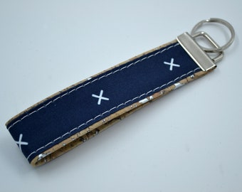Navy blue cotton keyring with white X patterned with natural cork, keyring, kit, strap