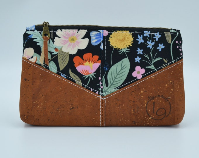Cosmetic kit, pencil cases, black fabric pouch with coloured flower patterns and cognac cork