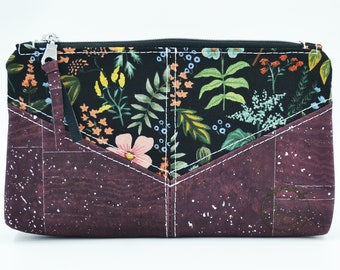 Cosmetic kit, pencil cases, black fabric pouch with coloured floral patterns and purple and silver cork