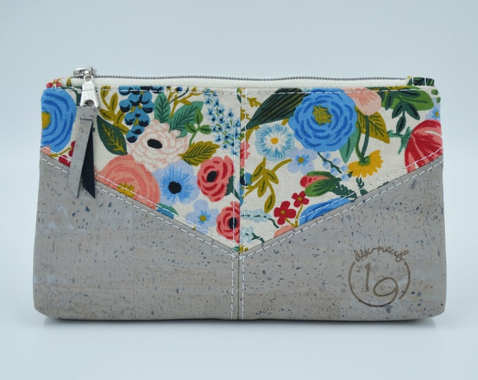 Cosmetic kit, pencil cases, cream fabric pouch with a coloured flower pattern and grey cork