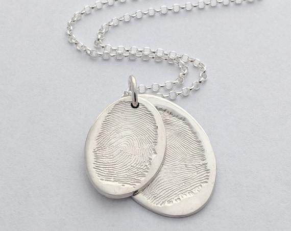 Oval sterling silver descending fingerprint necklace