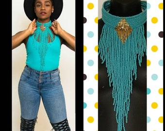 Teal and gold choker necklace.