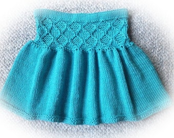 Jade Diamond - A Super Cute Short Skirt Knitting Pattern For Girls Ages 2-10. This pattern include links to video tutorials.