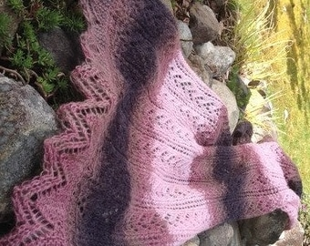 Light & airy lacy scarf/shawl with elegant lace borders.  It would be perfect for any occasion, really.
