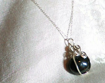 Sterling silver wire wrapped blood stone pendant.