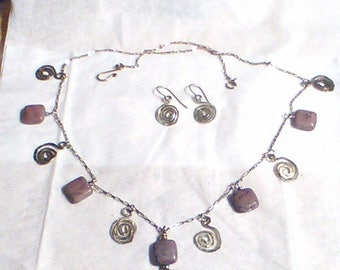 Necklace and earring set. Puffed square rhodochrosite beads and textured sterling silver swirls on a sterling chain