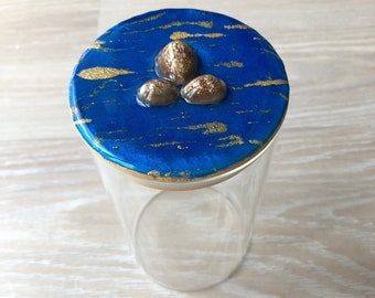 Cowry shell and resin glass container