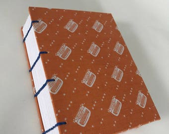 Handmade Coptic Journal: Exposed sewing and fabric hard covers.