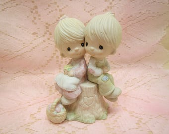 "1976 Precious Moments  "" Love one another"" Enesco  boy and girl on stump"