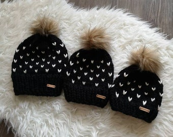 e69d0416 Adult Toque (One Item) | Black with Cream Hearts and Tan Faux Fur Pom Pom