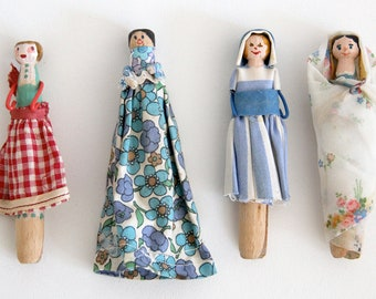 Vintage handmade peg dolls with painted features and fabric clothing x4