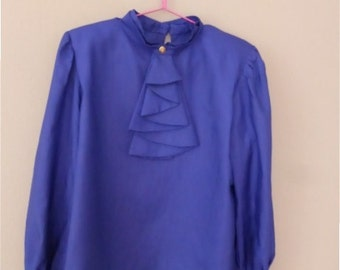 80s oversized shirt. XXL size. Electric blue party polyester top with ruffle at front & shoulder pads. In a very good vintage condition.