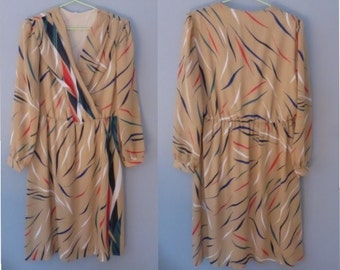 80s nylon dress. XXL size. Longsleeved beige retro dress with multicolor motifs, fully lined. In a good vintage condition.