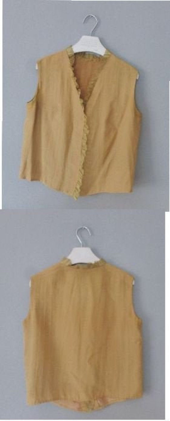 Mustard yellow sleeveless polyester top with ruffled detail In a very good vintage condition. XL size 60s chic blouse straight fit