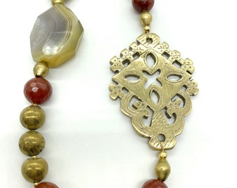 Faceted red agate and brass Ethiopian cross necklace
