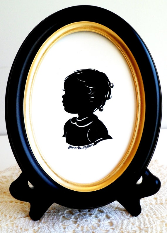 3 Silhouettes / one 5x7 black wood oval frame