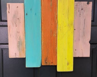 Colorful wall hanging of pallets recycled