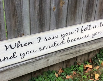 """S-189 Handmade, Wood, Long Sign with saying. """"When I saw you I fell in love and you smiled because you knew"""" 44 x 5 1/2 x 3/4. Warm."""