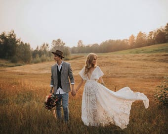 The Amazing lace 'Nomadic Dreamer' wedding gown available in ivory or white all sizes and one of a kind so will vary in lace pattern