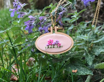 Embroidery hoop necklace with a field of flowers