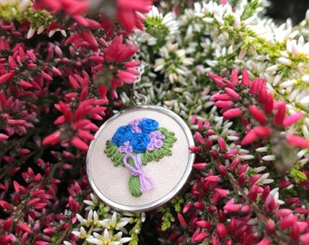 Embroidered necklace pendant with bouquet