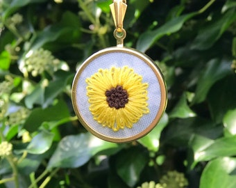 Embroidered necklace pendant with sunflower