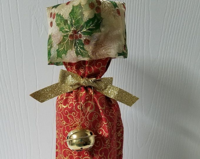 Ready to ship Red with gold  swirls fabric Christmas wine bottle bag with cuff and ornament