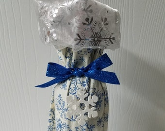 Ready to ship Blue or Red snowflake and swirl fabric Christmas wine bottle gift bag with Silver snowflake cuff and ornament