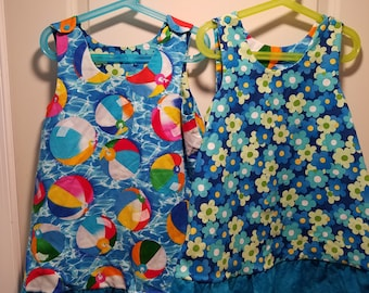 Reversible Dress, jumper, sundress, pinafore Toddler and Kids sizes in beach balls and retro daisies with ruffle