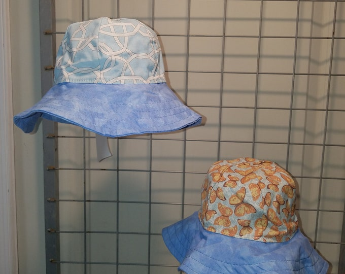 Reversible Sun Hat with Blue and white lattice and yellow butterfly with blue brim