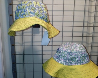 Reversible Sun Hat with green butterflies and a geometric print with an apple green brim