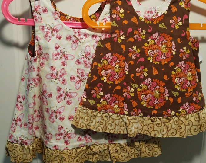 Reversible Dress, jumper, sundress, pinafore pink butterfly and swirls of color on brown with gold ruffle