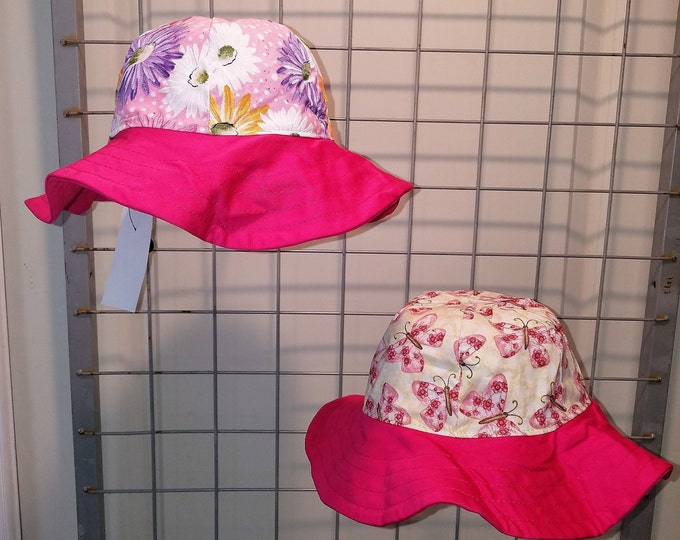 Reversible Sun Hat with Daisies and Butterfly with a hot pink brim