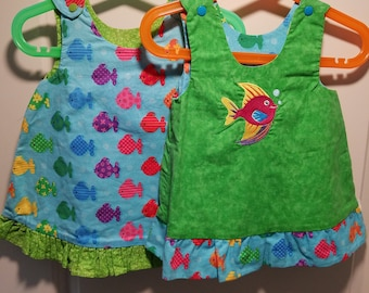 Reversible rainbow fish jumper last two in this dress sizes 3-6 months and 9-12 months